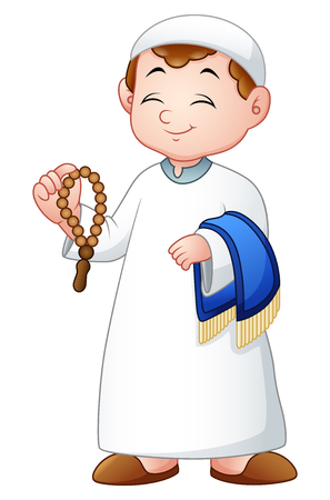 Muslim kid holding praye beads and prayer rug Stock Photo