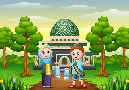 Muslim boy and girl cartoon holding lantern with mosque background Stock Photo