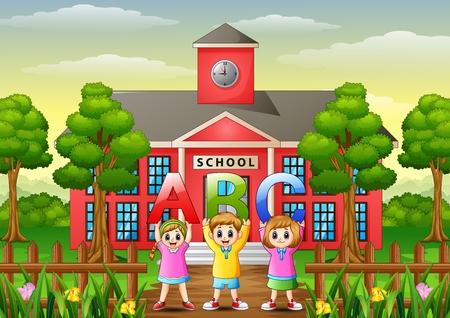 Happy children showing alphabets in front of school building