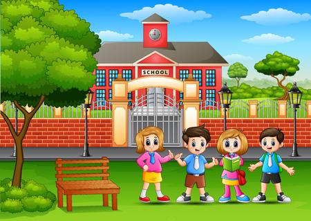 Šťastné školní děti stojí před budovou školy
