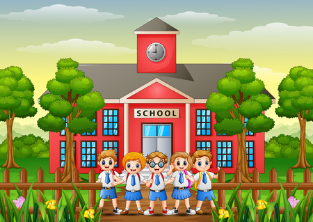 Happy school childrens in front of school building Stock Photo