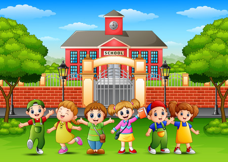 Happy school children standing in front of school building