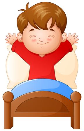白い背景の上のベッドで目を覚ます少年