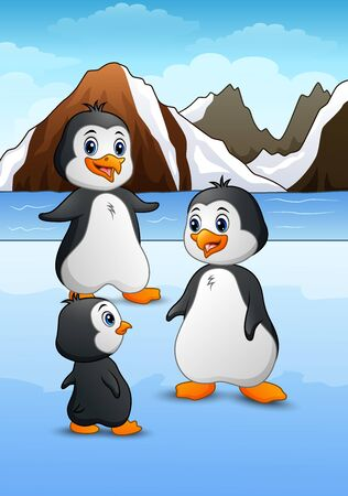 Penguin family standing on icy landscape
