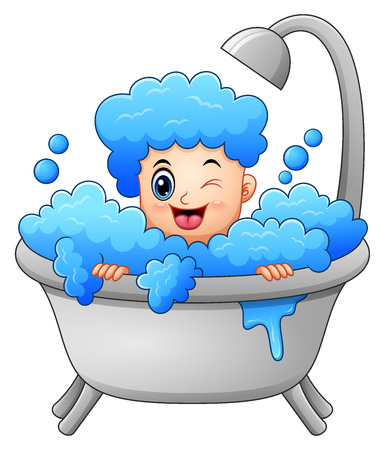 Boy taking a bath with soap bubbles