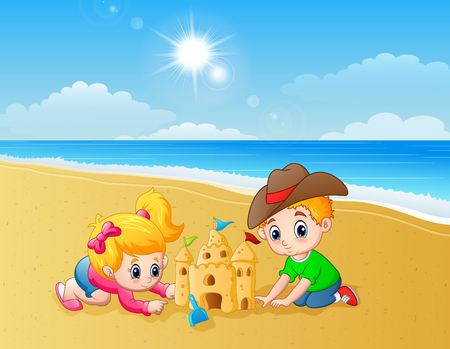Kids making sand castle at the beach Stock Photo