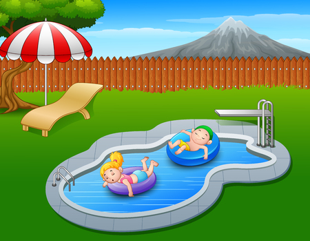 Kids floating on inflatable ring in the pool