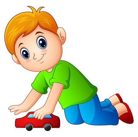 Little boy playing a toy car.