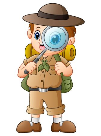 Boy explorer with magnifying glass Stock Photo