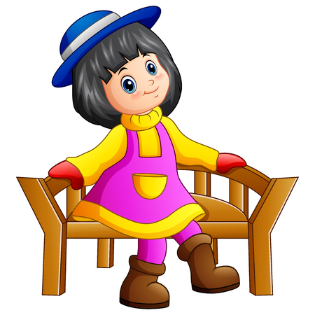 Beautiful little girl sitting on wooden bench Stock Photo