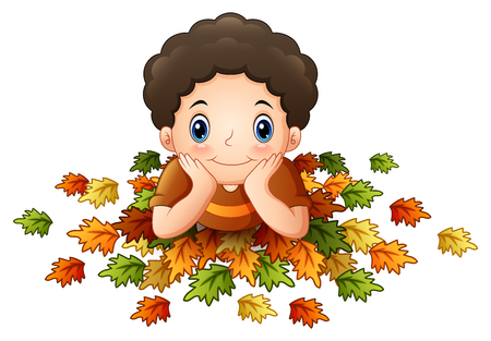 lay down: Cute little boy with autumn leaves