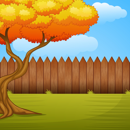 Garden background with autumn tree and wooden fence