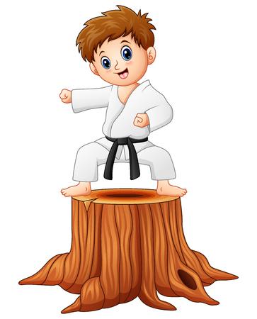 Little boy doing karate on tree stump Stock Photo
