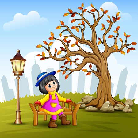 Little girl sitting on city park bench with town background