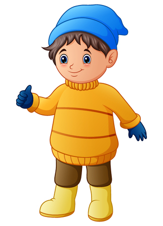 Happy boy in yellow winter clothes giving thumbs up