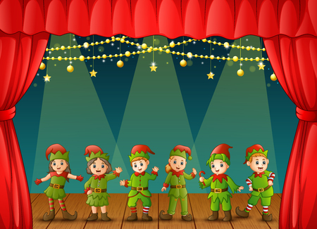 Christmas elves performing on stage 免版税图像 - 90963756