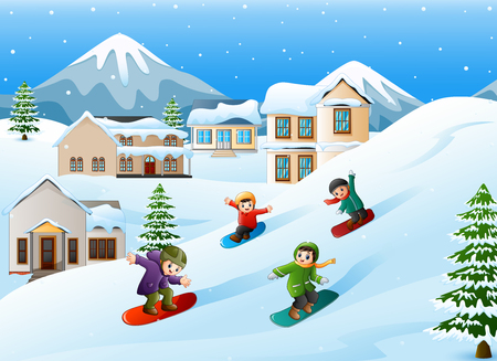 Children snowboarder sliding down hill Stock Photo