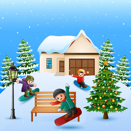 Happy kid playing snowboard in the snowing village Stock Photo
