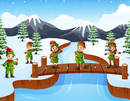 Happy kid wearing elf costume on the bridge in the snowing hill Imagens