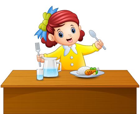 숟가락과 포크 테이블에서 식사를 들고 행복 소녀