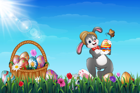 Vector illustration of Easter bunny holding Easter eggs with a butterfly. Easter Wicker basket full of decorated Easter eggs in a grass field