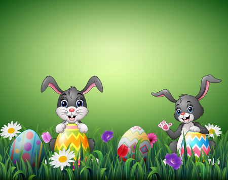 Vector illustration of Two happy rabbit cartoons with easter eggs in a field