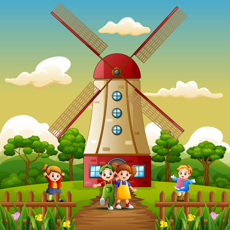happy kids playing in front of windmill building background