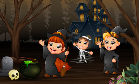 Happy kids celebration halloween day with haunted house background