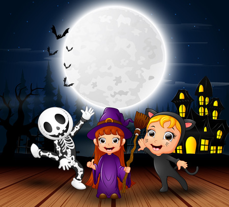 Happy halloween kids with scary house and full moon in the night