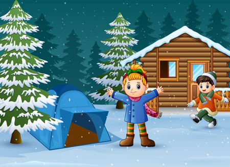Happy kids to wear winter clothes and play in front of a snowy wooden house