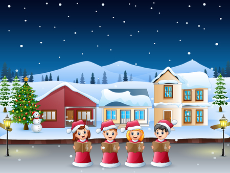 Group of kids in red santa costume singing christmas carols in the snowy village