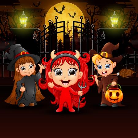 Happy kids wearing halloween costume outdoors at night Stock Photo