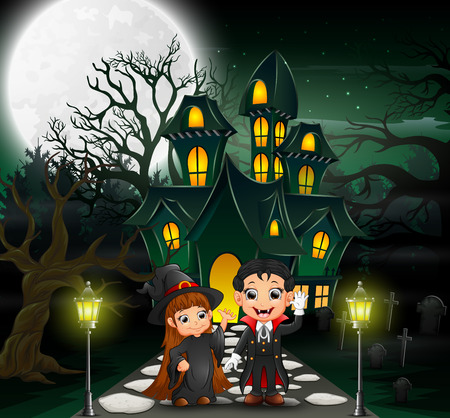 Happy halloween vampire and witch in front of the haunted house with full moon background Stock Photo