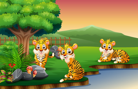 Tiger cartoon are enjoying nature by the river