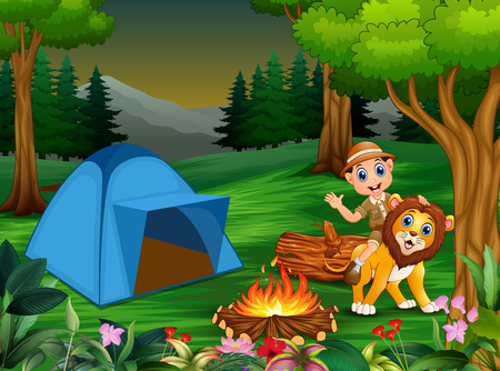 Zookeeper boy and a lion next to the tent and bonfire