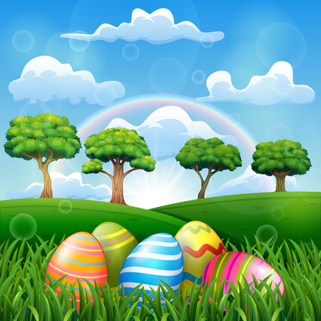 Easter egg on the grass field with a rainbow background in beautiful nature