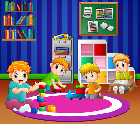 Children playing with toys in playroom of kindergarten