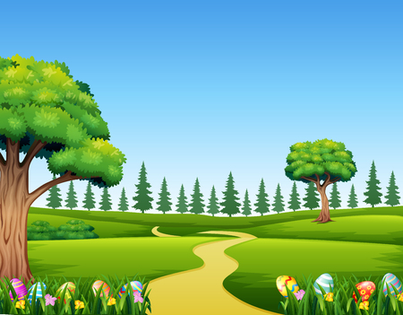 Colorful Easter eggs on green grass with beautiful landscape