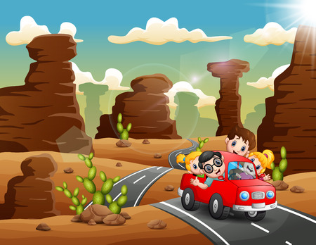 Happy children traveling by red car through the desert