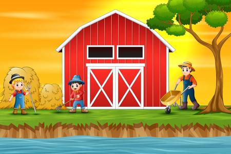 Agricultores que trabajan frente a un granero.