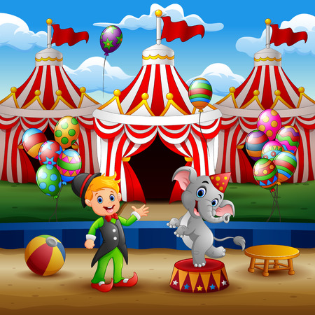 Circus elephant and trainer on the arena with circus tent background