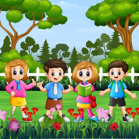 Happy school children standing in the park