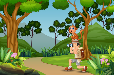 Happy explorer man with a monkey in the jungle