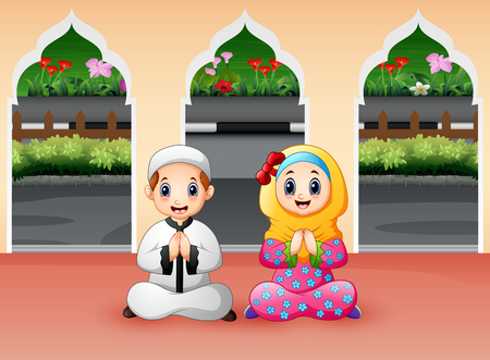 Muslim boy and girl are praying at Mosque