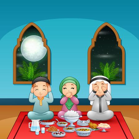 Muslim family pray together before break fasting
