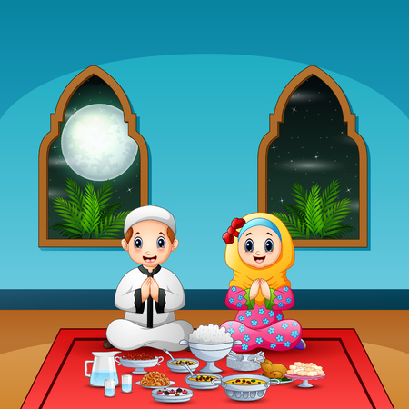 Muslim couple pray together before break fasting