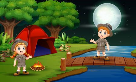 Scout boy and girl are camping in the nature at night