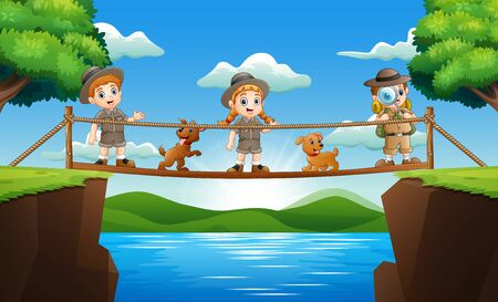 Three zookeeper standing on a wooden bridge