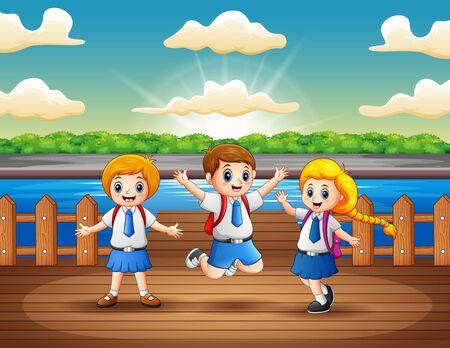 School children having fun at the wooden pier