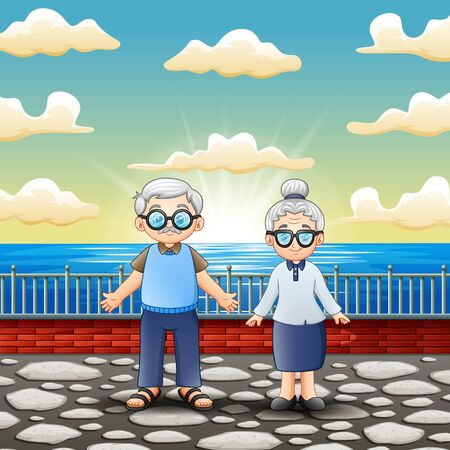 Happy old couple standing near the sea